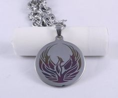 It's hard to find phoenix or peacock jewelry that isn't a) cutsie or cheap looking or b) way to expensive. This one is okay but more suited to a dude. Phoenix Necklace / Phoenix Pendant / Phoenix Rising / Phoenix Wings / Phoenix / Fire Bird / Pendant Necklace / Pheonix / Pheonix Necklace