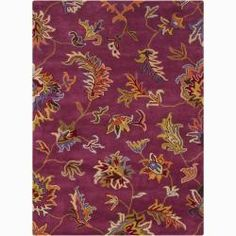 Flowers and leaves in orange, gold, green, brown, and beige weave across a plush purple backdrop, made in premium quality wool from India 7 x 10 is $270. quite a deal!