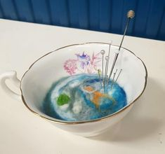 Found this gorgeous cup in a charity shop the other day - I didn't want to felt all the way up as it would cover the decoration inside the cup - decided to make a pond felt pin cushion.   Pretty happy with the results - running a workshop in a few weeks so that you all can make teacup pin cushions - all materials included.  #feltmaking #teacuppincushion #Edinburgh