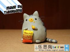 Pusheen figure. I WANT IT SOOO BAD I LOVE PUSHEEN!!!!
