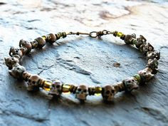 Day of the Dead Bracelet Made With Antiqued Copper Skulls, Glass And Brass by GinnyWolfStudio on Etsy