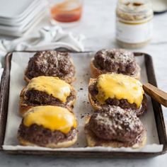 """Daddy's Hamburgers"" mini-cheeseburgers baked open face in the oven. The key to these burgers are not only good quality meat and great bread but a pat of butter that melts into the burger to create the juiciest, flavor-filled burger you'll ever devour."