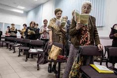 """Jehovah's Witnesses sing songs during a meeting in Rostov-on-Don, Russia, in November 2015. The country's top prosecutor is threatening a nationwide ban for alleged """"extremism."""""""