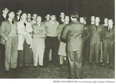 Sigma Nu fraternity brothers sing during Mothers Day of Junior Weekend 1942.  From the 1943 Oregana (University of Oregon yearbook).  www.CampusAttic.com