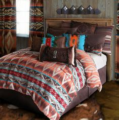 Mojave Sunset by Carstens Lodge Bedding captures the charm and colors of the southwest style beautifully. An accent of turquoise highlights the earthtones in rich shades of brown, red and a touch of sunset orange. Mojave Sunset creates the ideal collection of bedding for your lodge, cabin, or casita. Mojave Sunset is available in comforter sets in sizes from Twin to King. Comforter sets include comforter, pillow shams (one for twin set), coordinating bedskirt, and decorative 14