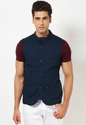 Trendy and versatile, this navy blue coloured waistcoat from the house of United Colors of Benetton is designed as per the latest trends.  This waistcoat is all you need to add a dash of style to your outfit.  Made from 100% cotton, this waistcoat is lightweight and easy to maintain. Wear it over a T-shirt to look sexy.