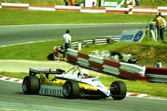 rene arnoux 1979 | Rene Arnoux - Renault RE30B - rounds Surtees during the 1982 British ...