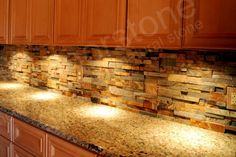 I like this stone backsplash but not the counters or cabinets