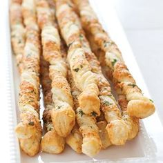 Party-Perfect: Homemade Cheese Straws 1 (9 1/2 by 9‐inch) sheet puff pastry, thawed 2 ounces parmesan or asiago cheese, grated (1 cup) 1 tablespoon minced fresh parsley 1/4 teaspoon salt 1/8 teaspoon pepper