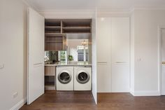 Mont Albert - Laundry After Hidden Euro Laundry White 2Pac doors with Brass hardware Mirror Splashback