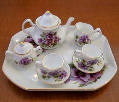 "Miniature ""Royal Castle"" Tea Set. White w Gold Trim w Pansy Motif. Tray, Teapot w Lid, Sugar w Lid, Creamer, Two Cups, Two Saucers."