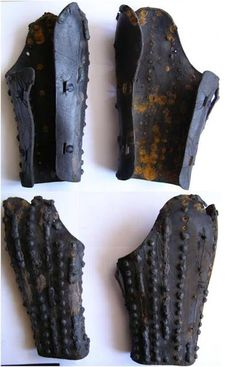 Leather bracers, 1360s, Tartu, Estonia. Iron details had all but rusted away completely. Leather is most likely horse leather & cuir bouilli. Metal details were riveted to the leather base - steel strips alternately with rows of rivets & also buckles. Likely waxed or greased for weatherproofing.  Possibly made locally or in Germany.  In Tallinn, leather arm guards are mentioned among defense equipment distributed to males around 1360. The first discovery of medieval leather arm guards in Europe.