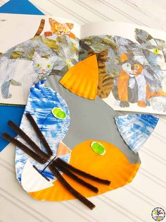 Have you ever found a children's book author that you just loved and adored? Eric Carle has always been one of our favorites! From his creative books to his amazing illustrations, we often find ourselves reading his books over and over again. What better way to celebrate an author or a book that you love then to pair it with a fun craft! Once we read the book Have You Seen My Cat?, we just had to create this Paper Plate Cat Craft. #craftforkids #bookcraft #paperplatecraft #bookinspiredcraft