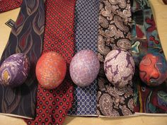 Wrap eggs in a silk tie, thread to hold it on, and boil 20 - 30 minutes.