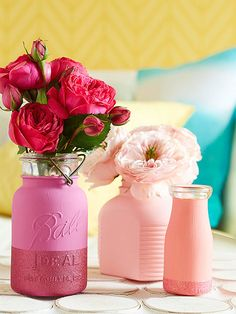 Painted Vases - While one paint color is good, two are even better. Add in some glitter and you have a knock-out DIY project. Paint the outside of jars and glass containers with two coats of clay paint. We mixed several shades of pink with white to create a range of hues. For a touch of glam, mask off the top of the jar with painter's tape and cover the bottom with glitter spray paint.