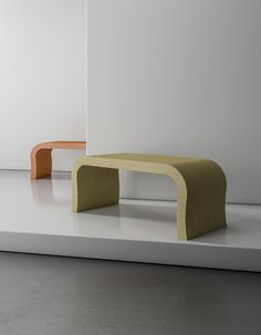 The Curved Coffee Table from Zespoke in orange gloss and a natural Oak finish. Perfect all in one colour like pictured or can be made in a combination of colours. All Zespoke furniture is hand built to order in the UK.