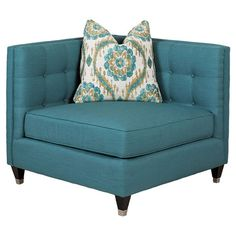 A stylish addition to your living room seating group or den, this lovely corner chair showcases button-tufted upholstery and a coordinating toss pillow....