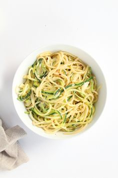 Garlic-Parmesan Zucchini Noodles and Spaghetti Pasta - add a spiralized onion with the garlic!