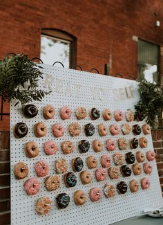 A donut wall is the sweetest idea | Image by Nicole Veldman Photography + Video
