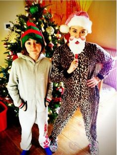 Miley Cyrus' sister in a 1D onesie omg her sister looks exactly like miley