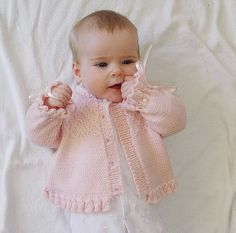 This listing is for the PDF of the knitting pattern ONLY. This pretty little girls jacket/sweater has beautiful detail on the bodice and a frilly