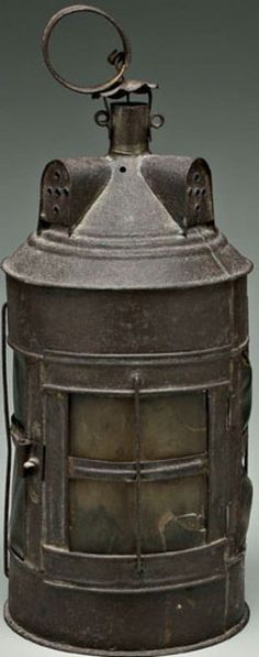 Tin and horn lantern, cylindrical with conical top with three dormer type ventilators, horn panels, English, 18th century.