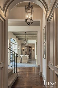 That millwork inspired the entry hall's ceiling—and its gray hue—which was designed by Kyle. Walnut flooring from Schenck & Company runs underfoot.