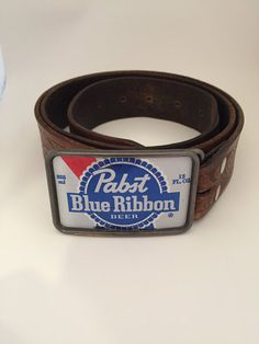 It is the logo from the beer can inserted onto a 3 x silver colored rectangular belt buckle. Check out our other listings and if we do not have what you are looking for, we can custom-make one for you. Pabst Blue Ribbon, Ribbon Belt, Belt Buckles, Silver Color, Are You The One, Antique Silver, Upcycle, Beer, Man Stuff