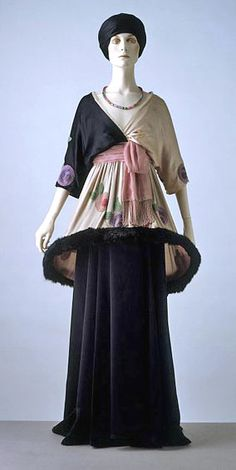 """Another controversial action was Poiret's introduction of the v-neckline for daywear. This exposure of skin was considered a sure way to contract pneumonia.  """"Sorbet"""" chiffon, satin, fur skirt and tunic, 1912."""