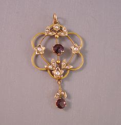 VICTORIAN 14k yellow gold and garnet doublettes lavaliere from Morning Glory Jewelry. Buy now for $288.00