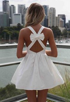 noemi_konta90's save of White Blessed Angel Dress Cross Bow Back from xeniaeboutique on Wanelo