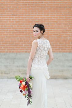 Wedding gown from BHLDN. Photography: CharlaStorey.com -- See more on #SMP: http://www.StyleMePretty.com/2014/05/05/spanish-style-wedding-inspiration