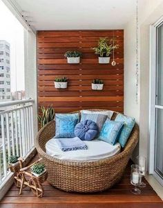 Cozy porch papasan with wall planters and pallet wall