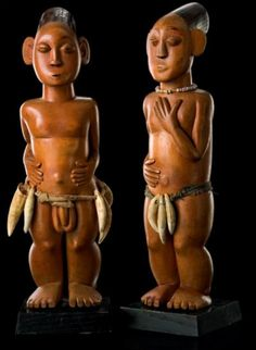 a pair of ancestor figures from the Congolese area of Uele.  The sculpture depicts a male and female with compact bodies expressed with voluminous, round forms, flat relief arms and elaborately carved hands.
