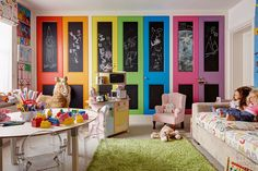 Room really captures all the bright colors that usually come along with kids. The alphabet fabric, ghost chairs and multi-colored closets are going in my kid-room file for sure. Michael reeves