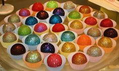 Edible Glitter Cake Balls. 1/4 cup sugar and 1/2 teaspoon of food coloring mixed, bake10 mins in oven on 350* to make edible glitter