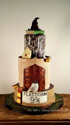 This Marvelous Harry Potter Cake was made by The Bee's Knees Custom Cakes. The bottom of the cake has the train station Gateau Harry Potter, Cumpleaños Harry Potter, Harry Potter Birthday Cake, 10 Birthday Cake, 10th Birthday, Amazing Birthday Cakes, Harry Potter Desserts, Harry Potter Wedding Cakes, Birthday Recipes