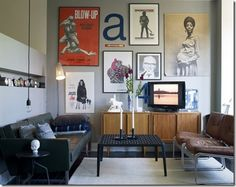 Gretchen says: Neutrals are set off by this gallery wall. All the furniture is on legs. This keeps it modern. Love the one pop of color. It makes a statement.