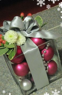 """""""Present / Gift"""" Centerpiece = glass cube vases, any color ornaments, ribbon bow, can add flowers or greenery"""