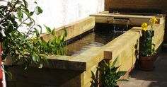 New raised Pond made from new pine railway sleepers