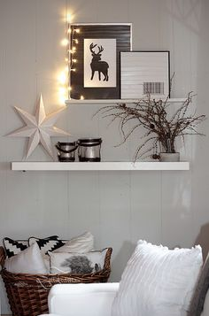 Basket for pillows in corner with shelves and photos