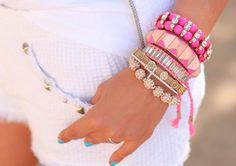 Plum Pretty Sugar; bright bracelets with all white and turquoise nails