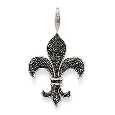 Thomas Sabo Pendant. 'Bourbon Lily' 925 sterling silver black cubic zirconia pavé fleur de lys. The fleur de lys is French for 'lilly flower' and is probably the best known symbol of the French monarchy and one of the most popular heralsic motifs. It represents purity and power. This pendant is on a sterling silver parrot clasp. Size: 3.4 cm.