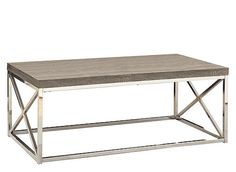 With a dark taupe reclaimed wood-look top, this hollow-core cocktail table gives an exceptional look to any room. The modern rectangular shape and criss-cross chrome metal base provide sturdy support as well as a contemporary look. Use this multi-functional table to complement your living space.