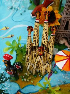Sara Drake - Spain and Portugal detail from large 3D world map. Maps are made from mixed media, including papier mache, balsa wood, acrylic paint, beads and wire. All details are hand made and to commission. Each map is personalised with the details of the client's own travels. saradrake.com