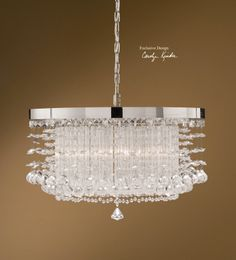 Hang this classic contemporary chandelier over a farm table or a sleek black dining table.  Be able to mix it up a bit now and then :-)