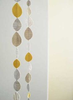linen leaf mobile as seen on apartmenttherapy.com.  a good way to use all those old fabric memos :)