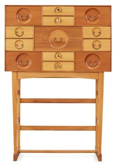 A Josef Frank cabinet on stand with thirteen different size  drawers,   by Svenskt Tenn 1960's.