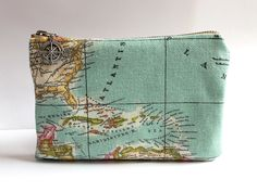 Vintage Map Toiletry Bag Personalized Groomsmen Gift, Travel Cosmetic Pouch, Destination Wedding Gifts for Him, Explorer Men Accessories. $30.00, via Etsy.