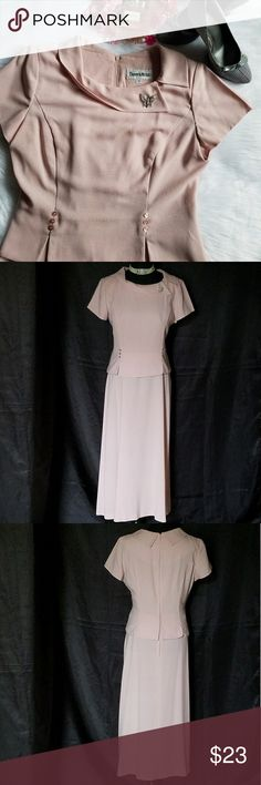 """Danny & Nicole Midi Dress Celebrate your special occasion in style with this pastel pink dress by Danny & Nicole. This one-piece dress features a fold over collar with back zipper closure, pink faux front buttons, and short sleeves with shoulder pads. Gently worn, still in excellent condition. Measures 49"""" from shoulder to hem, 19"""" from underarm to underarm. 100% Polyester - care label tag has been removed. Size 12. Add a pop of sparkle to this dress by adding a pretty jeweled brooch. No…"""
